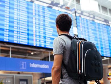 Man looking at flight departure board at airport