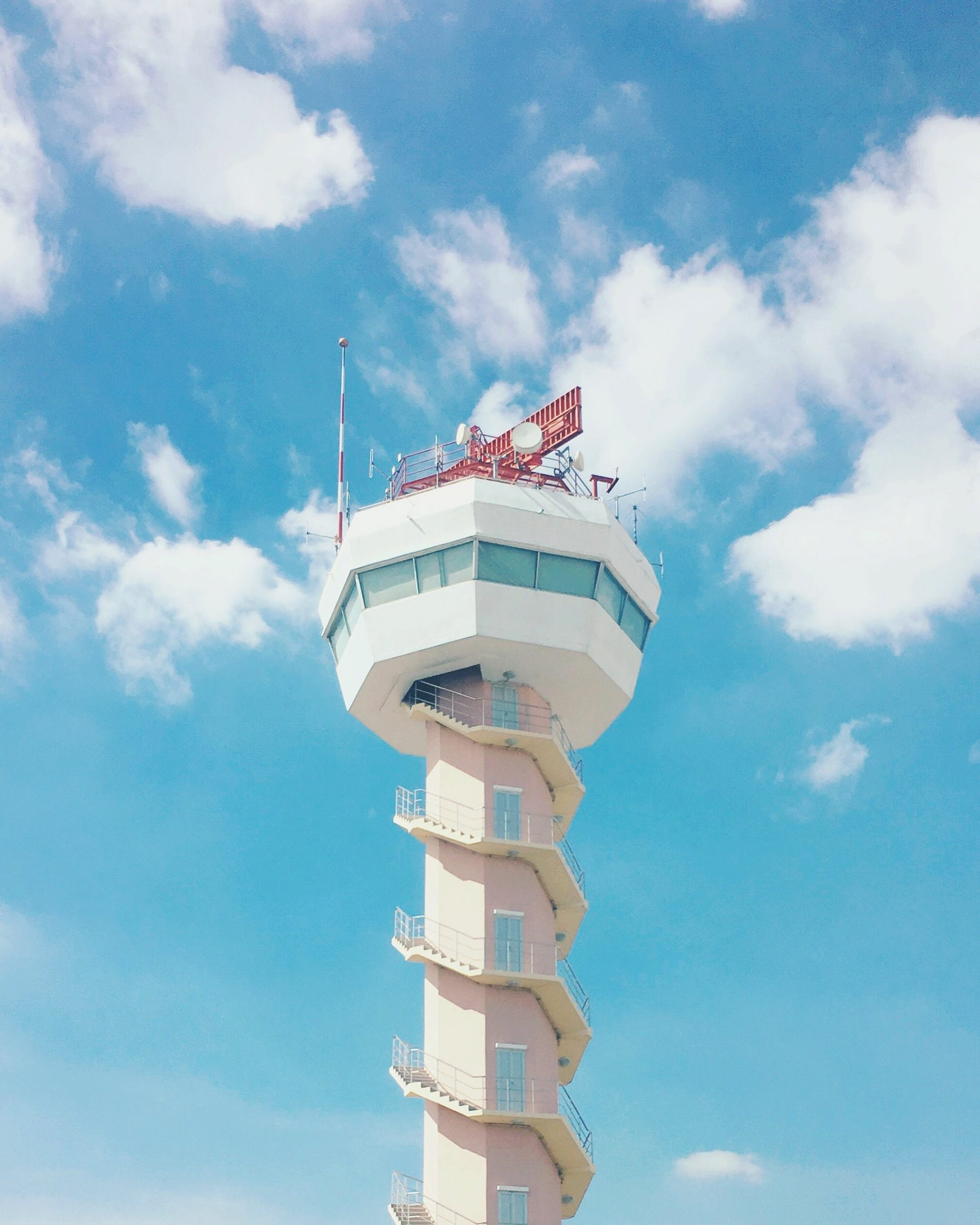 Air traffic control tower against sky background at airport